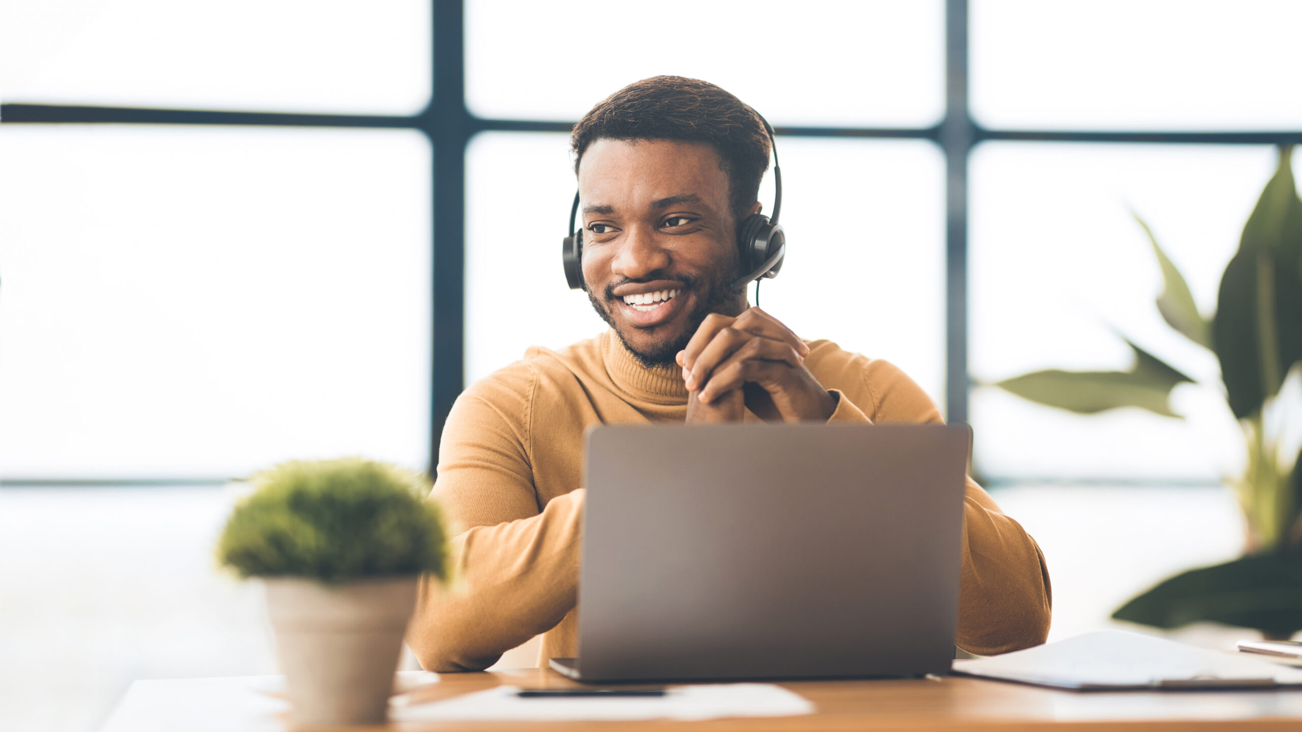 Happy afro manager working in call centre